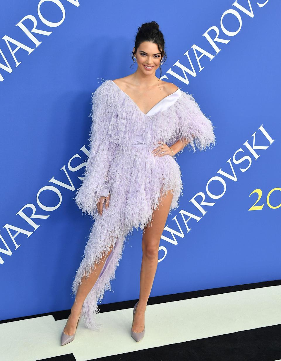 <p>Kendall Jenner was dressed by close friend Virgil Abloh for the ceremony, as she donned a feathered dress by Off-White. <em>[Photo: Getty]</em> </p>