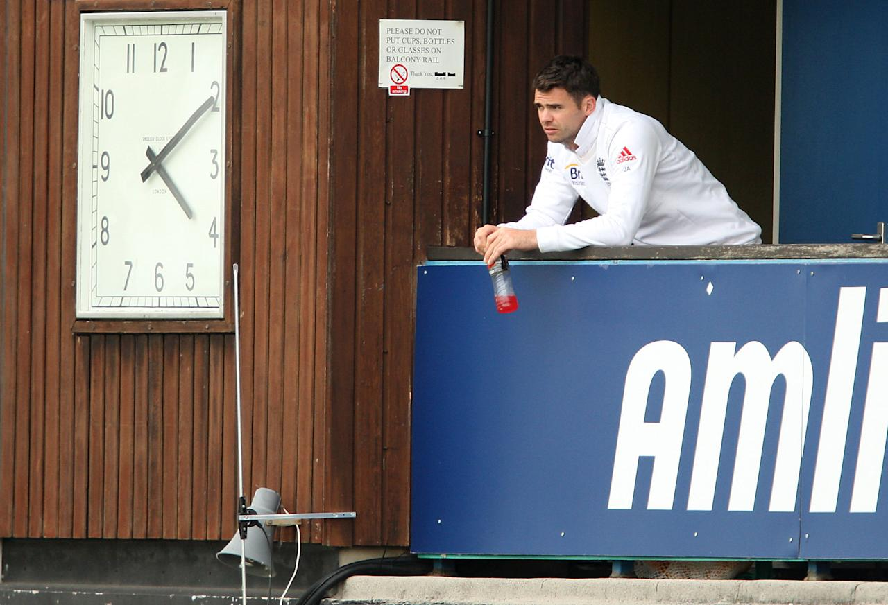 England's James Anderson looks on from the balcony during day four of the International Tour match at The County Ground, Chelmsford.