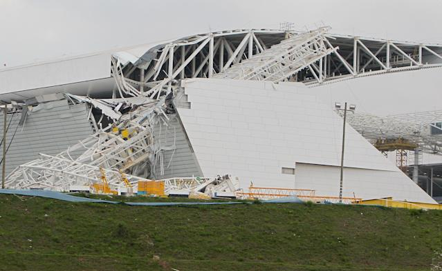 SAO PAULO, BRAZIL - NOVEMBER 27: A crane collapsed during construction on November 27, 2013 at Itaquerao Stadium in Sao Paulo, Brazil. According to reports, three workers were killed in the accident. The stadium is scheduled to host the opening ceremony of the World Cup in 2014. (Photo by Ricardo Bufolin/Getty Images)