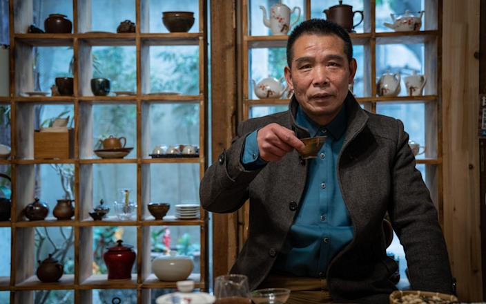 Mr. Liu, who would not give his first name, poses for a portrait in his tea studio in Wuhan - Yan Cong for the Telegraph