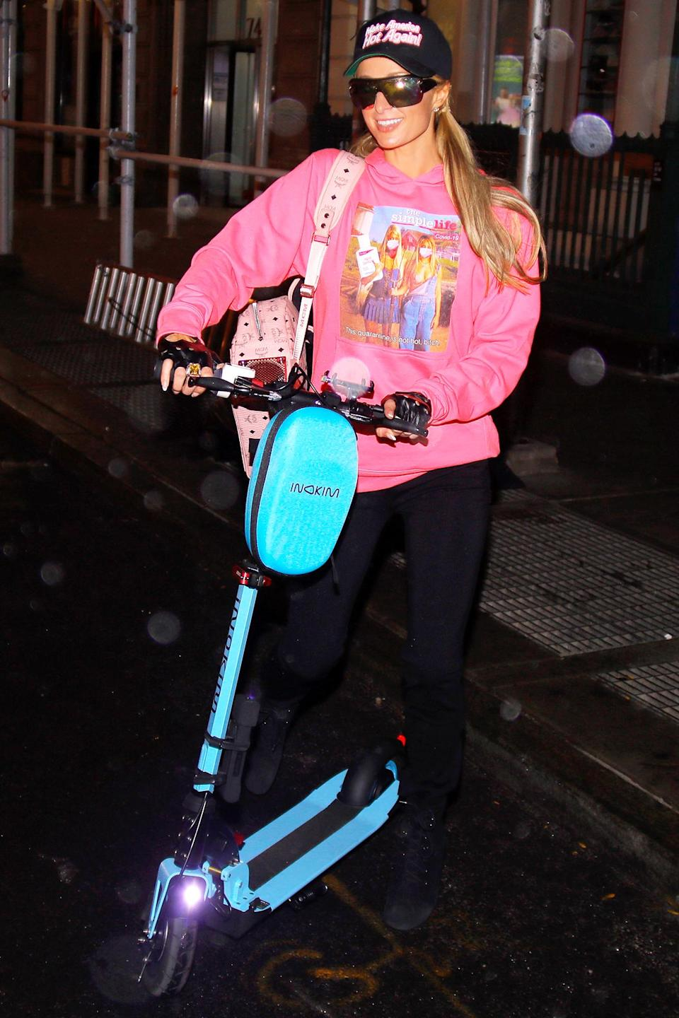 <p>Paris Hilton wore a 'Make America Hot again' hat and a Simple Life sweater while riding a scooter in New York City. </p>