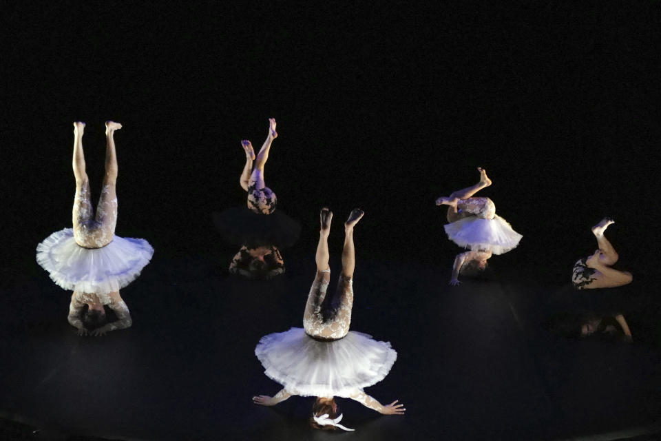 "Dancers, from left to right, Joaquin Medina Caligari from Uruguay, Tasha Petersen from Argentina, Valentino Martinetti from Argentina, Marius Fouilland from France and Lucille Chalopin from Paris, of the Eolienne company perform ""Le Lac des Cygnes"" by Florence Caillon, based on Tchaikovsky's Swan Lake during the BIAC, International Circus Arts Biennale, in Marseille, south of France, Thursday, Feb. 4, 2021. The fourth edition of the global Circus Biennale is demonstrating how the performing arts have a way of flourishing in between the cracks, celebrating the death-defying and spine stretching arts that go behind the storied spectacle. (AP Photo/Francois Mori)"