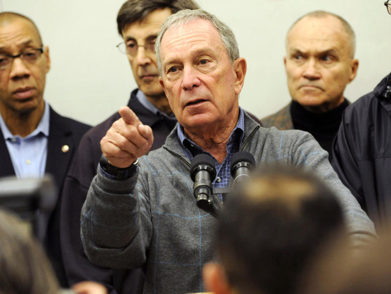 Mayor Michael Bloomberg speaks to the media at Seward Park High School on the lower east side, the site of one of many public shelters set up in preparation of the storm, Sunday, Oct. 28, 2012, in New York. Tens of thousands of people were ordered to evacuate coastal areas Sunday as big cities and small towns across the U.S. Northeast braced for the onslaught of a superstorm threatening some 60 million people along the most heavily populated corridor in the nation. (AP Photo/ Louis Lanzano)