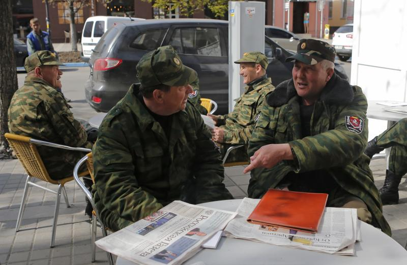 Members of pro-Russian self-defence units gather in the Crimean city of Simferopol