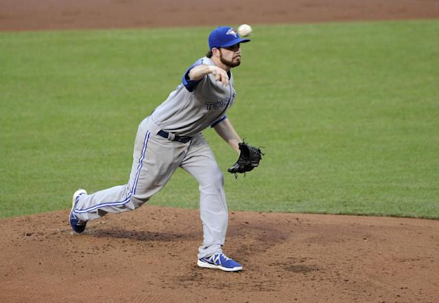 Toronto Blue Jays starting pitcher Drew Hutchison delivers against the Baltimore Orioles during the third inning of a baseball game on Friday, June 13, 2014, in Baltimore. (AP Photo/Nick Wass)