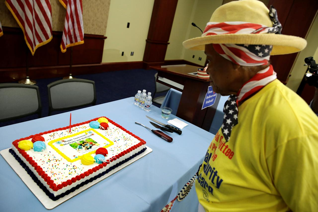 A participant looks at a cake before an event to celebrate the 52nd Anniversary of Medicare and Medicaid on Capitol Hill in Washington, U.S., July 27, 2017. REUTERS/Yuri Gripas