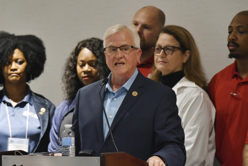 Terry Dittes, director of the UAW GM department, announces that GM workers will go on a national strike at midnight on Sunday Sept. 15, 2019 in the Marriott Renaissance Hotel, in Detroit, Mi. (Clarence Tabb, Jr./Detroit News via AP)
