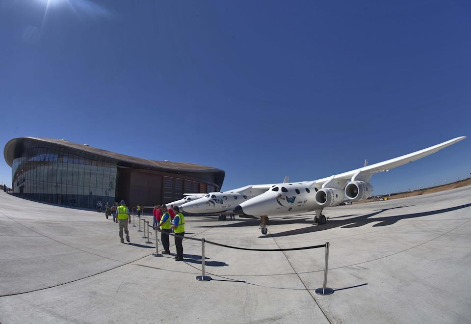 The new Spaceport America hangar backdrops the spacecraft White Knight Two spacecraft.