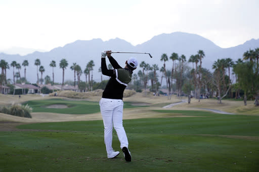 Si Woo Kim hits from the 17th tee during the second round of The American Express golf tournament on the Nicklaus Tournament Course at PGA West, Friday, Jan. 22, 2021, in La Quinta, Calif. (AP Photo/Marcio Jose Sanchez)