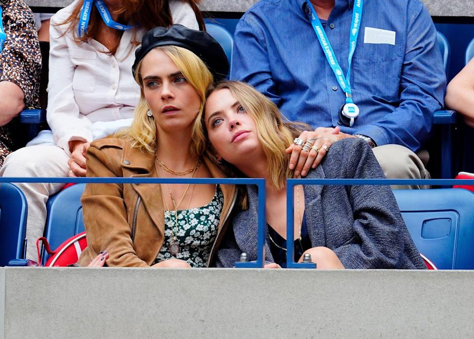 """<p>After meeting on the set of <strong>Her Smell</strong>, <a href=""""https://www.popsugar.com/celebrity/cara-delevingne-and-ashley-bensons-cutest-pictures-46602376"""" class=""""link rapid-noclick-resp"""" rel=""""nofollow noopener"""" target=""""_blank"""" data-ylk=""""slk:Ashley and Cara sparked dating rumors"""">Ashley and Cara sparked dating rumors</a> when they were photographed kissing at Heathrow airport in London. But it wasn't until June 2019 that Cara finally confirmed their relationship in honor of their first anniversary. She also briefly opened up about their private relationship in an interview with <strong>Marie Claire</strong>. """"We weren't looking for it,"""" Cara said, referencing the first time she and Ashley met. """"It was really just very authentic and natural."""" However, by April 2020, <a href=""""https://www.popsugar.com/celebrity/cara-delevingne-ashley-benson-break-up-47448269"""" class=""""link rapid-noclick-resp"""" rel=""""nofollow noopener"""" target=""""_blank"""" data-ylk=""""slk:the couple broke up"""">the couple broke up</a>.</p>"""