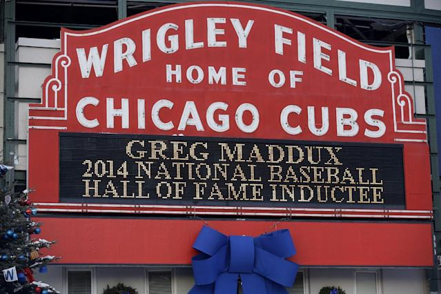 A sign at Wrigley Field in Chicago notes the election of former Chicago Cubs pitcher Greg Maddux to baseball's Hall of Fame on Wednesday, Jan. 8, 2014. Maddux, Frank Thomas and Tom Glavine were elected to baseball's Hall of Fame on Wednesday. (AP Photo/Nam Y. Huh)