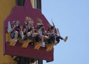 People enjoy a ride at Cinecitta World amusement park in the outskirts of Rome in the day of its reopening, Thursday, June 17, 2021. Amusement parks have been closed since Oct. 25 2020, when Italy's second national lockdown started. (AP Photo/Alessandra Tarantino)