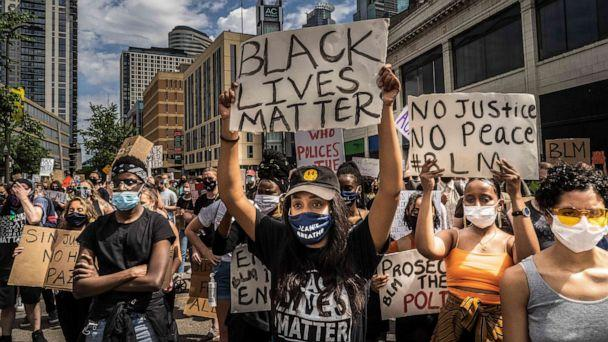 PHOTO: Protesters hold signs outside the Minneapolis 1st Police precinct during a demonstration against police brutality and racism on June 13, 2020, in Minneapolis. (Kerem Yucel/AFP via Getty Images, FILE)
