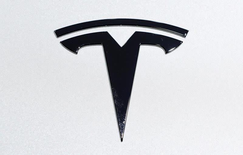 Tesla logo is pictured on an electric car at Brussels Motor Show