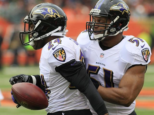 Baltimore Ravens cornerback Corey Graham (24) is congratulated by inside linebacker Daryl Smith (51) after intercepting a pass against the Cincinnati Bengals in the first half of an NFL football game on Sunday, Dec. 29, 2013, in Cincinnati. (AP Photo/Tom Uhlman)