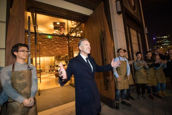Starbucks Chairman Howard Schultz welcomes guests outside a Chinese Starbucks.