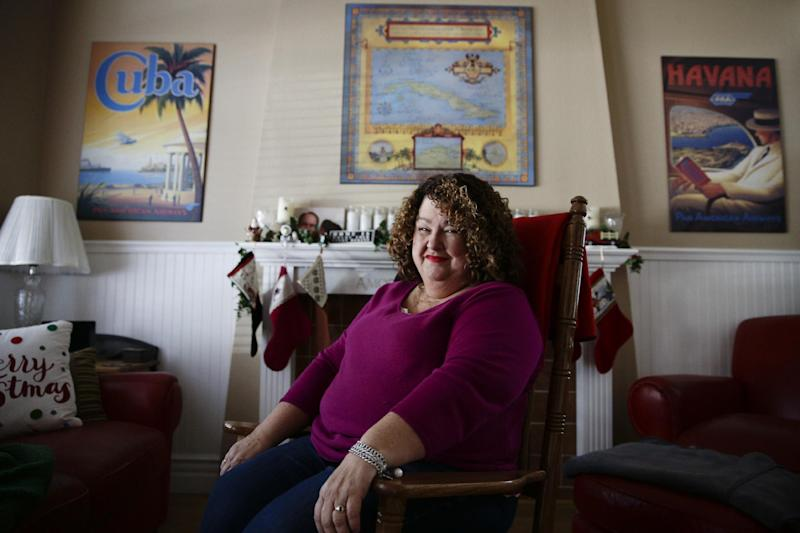 """Cuban food blogger Marta Darby poses for photos in her home on Tuesday, Dec. 17, 2013, in Mission Viejo, Calif. Darby will be making a toast to Cuba this year, accompanied with a glass of the rum-based eggnog known as the """"creme de vie"""" or """"cream of life."""" (AP Photo/Jae C. Hong)"""