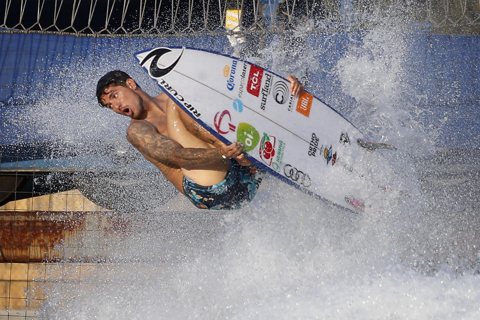 Surfer Gabriel Medina of Brazil works out on a Surf Ranch wave during practice rounds for the upcoming Olympics Wednesday, June 16, 2021, in Lemoore, Calif. This year, Medina and fellow Brazilian Italo Ferreira are expected to rule the men's competition at surfing's long-awaited debut as an Olympic sport in the Tokyo 2020 Games. While the surfing community has long pledged that the ocean is for everyone, a look at the professional ranks show a sport that remains expensive and inaccessible. A series of recent industry efforts to help groom the next generation outside of the usual hot spots of Hawaii, California and Australia look to be a tacit acknowledgement of the existing disparities among its talent bench. (AP Photo/Gary Kazanjian)