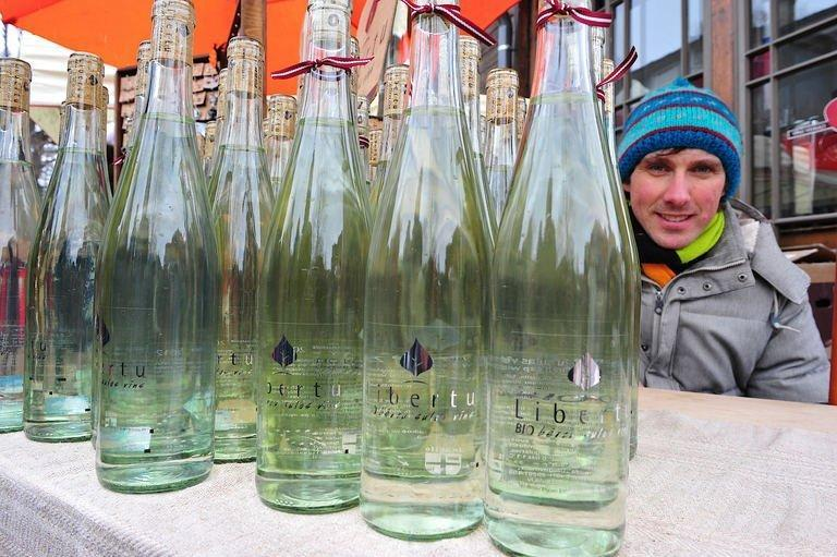 Linards Liberts sells bottled birch juice and wine at a Kalnciema street market in Riga on March 30, 2013. At his small organic farm in the central Latvian town of Ikskile, it is stacked full of his birch juice products: still and sparkling wines, syrup, lemonade and schnapps