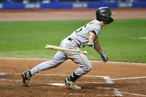 Pittsburgh Pirates' Adam Frazier hits a single off Cleveland Indians starting pitcher Carlos Carrasco during the sixth inning of a baseball game, Friday, Sept. 25, 2020, in Cleveland. (AP Photo/Ron Schwane)