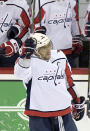 Washington Capitals left wing Alex Ovechkin (8) celebrates his 700th career goal during the third period of an NHL hockey game against the New Jersey Devils Saturday, Feb. 22, 2020, in Newark, N.J. (AP Photo/Bill Kostroun)