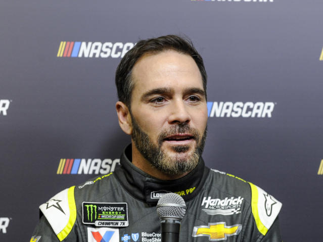 "<a class=""link rapid-noclick-resp"" href=""/nascar/sprint/drivers/213/"" data-ylk=""slk:Jimmie Johnson"">Jimmie Johnson</a> listens to a question about the new road course at the Charlotte Motor Speedway during the NASCAR Media Tour in Charlotte, N.C., Tuesday, Jan. 23, 2018. (AP Photo/Mike McCarn)"