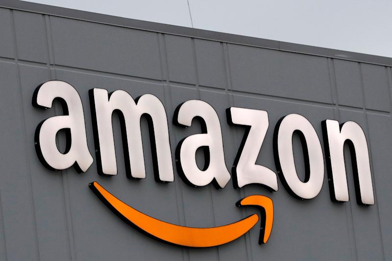 A sign is lit on the facade of an Amazon fulfillment center on Staten Island in New York. The company plans to hire another 100,000 new workers in their fulfillment centers to fill increased customer demand during the coronavirus outbreak in which many Americans are working from home and discouraged from going out. (Photo: ASSOCIATED PRESS)