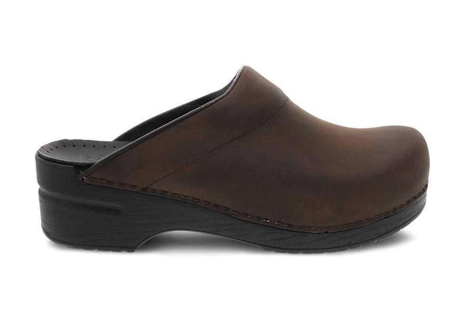 """Like adding fish sauce to a dish, tossing on a pair of far-out mules or thick-cut clogs will bring some sorely-needed funk to an otherwise bland ensemble.<br> <br> <em>Dansko """"Karl"""" antique brown sole clog</em> $125, Dansko. <a href=""""https://www.dansko.com/karl-antique-brown-black-sole"""" rel=""""nofollow noopener"""" target=""""_blank"""" data-ylk=""""slk:Get it now!"""" class=""""link rapid-noclick-resp"""">Get it now!</a>"""