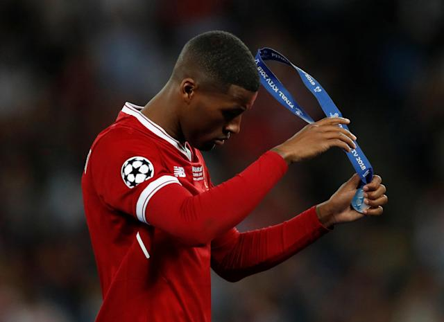 Soccer Football - Champions League Final - Real Madrid v Liverpool - NSC Olympic Stadium, Kiev, Ukraine - May 26, 2018 Liverpool's Georginio Wijnaldum looks dejected as he removes his runners up medal after the match REUTERS/Andrew Boyers