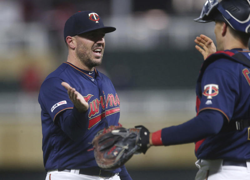 Minnesota Twins pitcher Ryne Harper, left, and catcher Jason Castro celebrate the Twins' 4-1 win over the Toronto Blue Jays in a baseball game Wednesday, April 17, 2019, in Minneapolis. (AP Photo/Jim Mone)