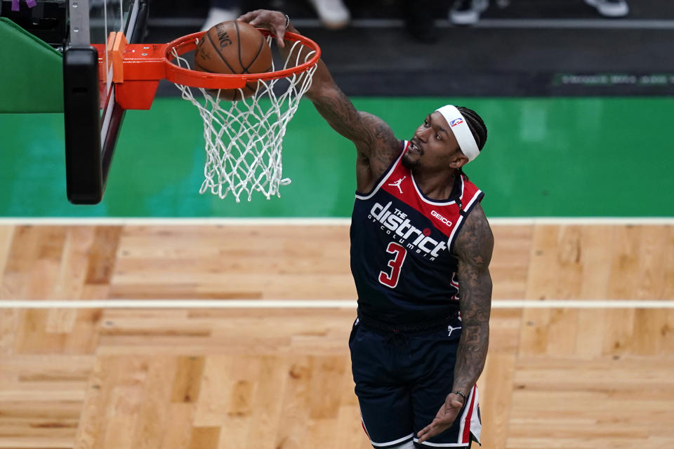Washington Wizards guard Bradley Beal (3) dunks against the Boston Celtics during the first half of an NBA basketball Eastern Conference play-in game Tuesday, May 18, 2021, in Boston. (AP Photo/Charles Krupa)