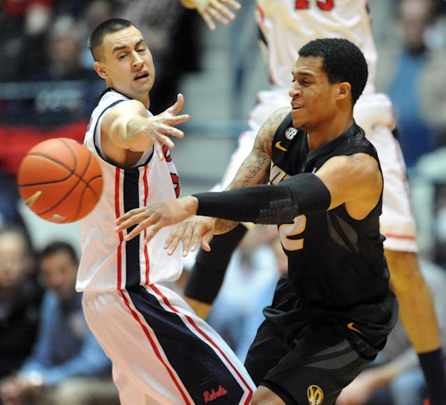 Missouri's Jabari Brown, right, passes around Mississippi's Marshall Henderson during an NCAA college basketball game in Oxford, Miss. on Saturday, Feb. 8, 2014. (AP Photo/The Oxford Eagle, Bruce Newman)