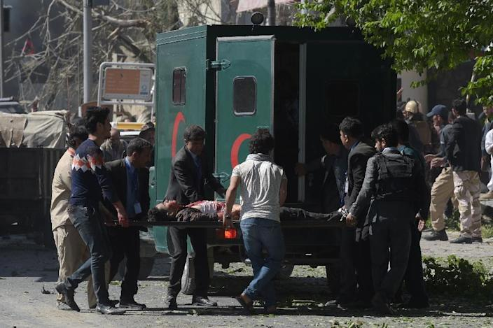 Ambulances rushed survivors to hospital after a huge blast, which struck during Kabul's rush hour (AFP Photo/SHAH MARAI)