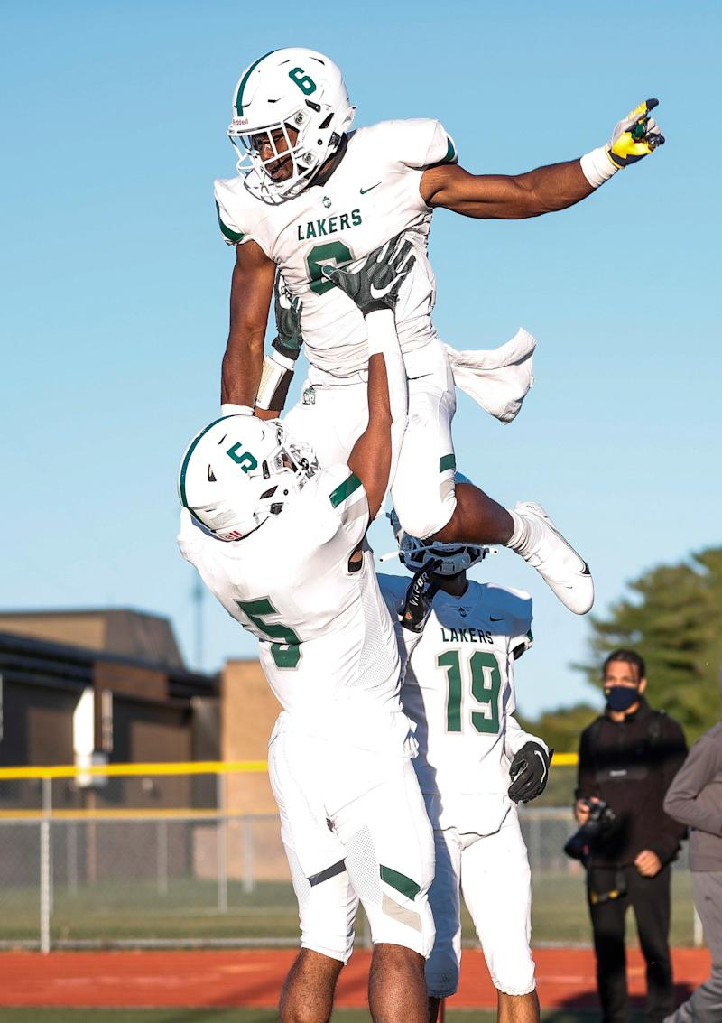 West Bloomfield running back Donovan Edwards, top, celebrates a touchdown against Oak Park with running back Dillon Tatum during the first half of season opener at Oak Park High School on Friday, Sept. 18, 2020.