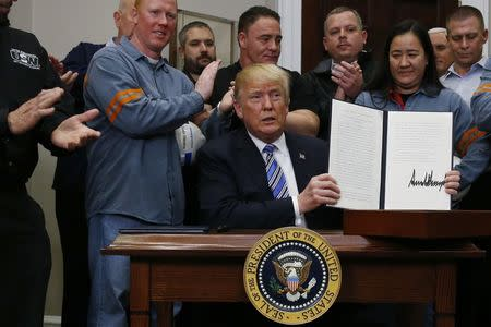 U.S. President Trump hosts signing ceremony to establish tariffs on imports of steel and aluminum at the White House in Washington
