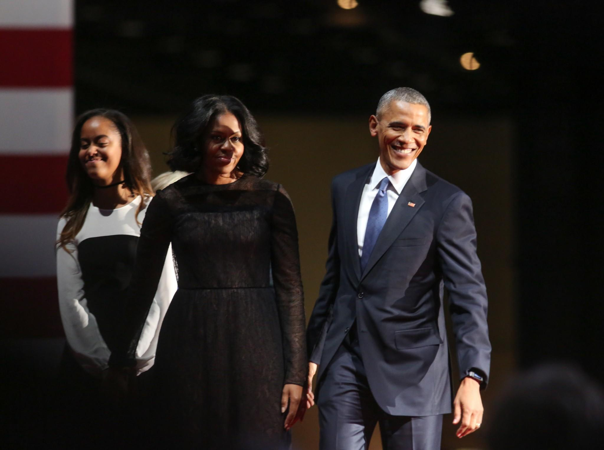 Malia and Michelle Obama join President Barack Obama on stage at his farewell address. (Photo: Getty Images)