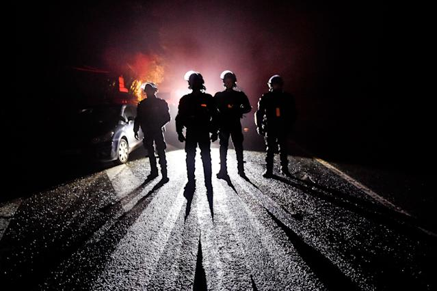 <p>French riot police officers stand guard during the eviction of environmental protesters from the site, known as ZAD (Zone a Defendre – Zone to defend) of what had been a proposed new airport in Notre dame des Landes on April 9, 2018. (Photo: Loic Venance/AFP/Getty Images) </p>