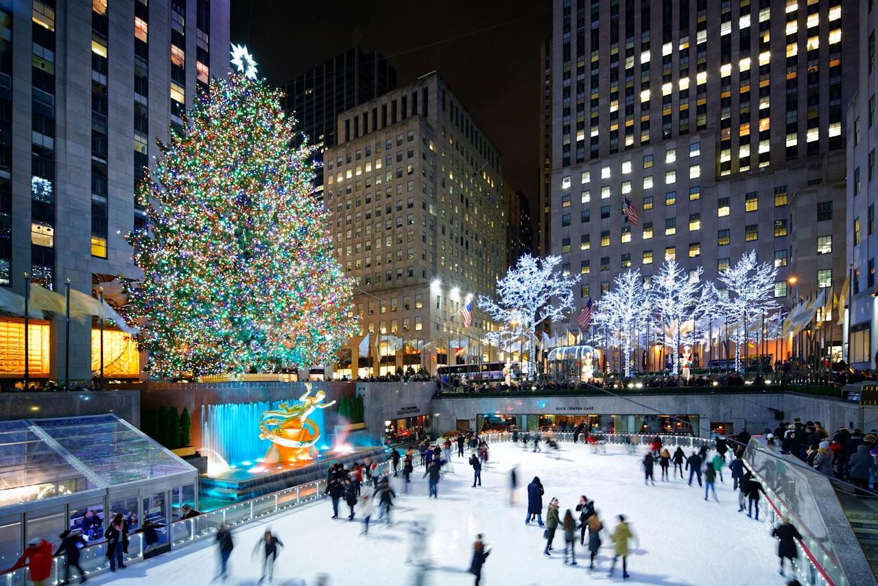 """A must-see for <a href=""""http://www.cntraveler.com/gallery/how-to-have-a-new-york-christmas?mbid=synd_yahoo_rss"""">every Christmas fanatic</a>, the 77-foot-tall Norway spruce at Rockefeller Center is wrapped with a whopping five miles of wire decorated with some 45,000 lights. The first tree was lit in 1933, and now more than half a million people walk by the tree daily, stopping along the way to skate on the famed ice rink. Catch this year's epic tree lighting ceremony on Wednesday, December 4."""