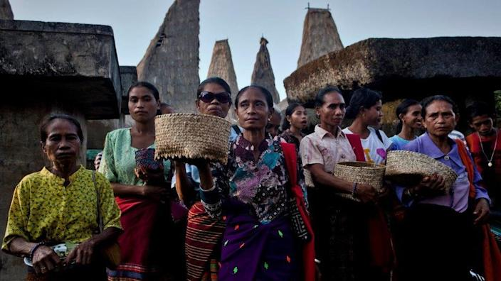 Sumbanese women perform rituals to the grave of their ancestors.