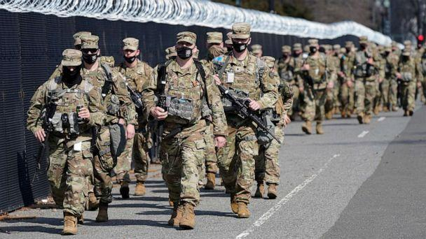 PHOTO: National Guard walk near the Capitol, March 4, 2021, in Washington, D.C. after police said they have uncovered intelligence of a 'possible plot' by a militia group to breach the U.S. Capitol on Thursday. (Jacquelyn Martin/AP)