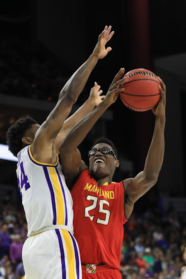 <p>Maryland's Darryl Morsell (11) takes a shot against LSU's Kavell Bigby-Williams, left, during the first half of a second-round game in the NCAA men's college basketball tournament in Jacksonville, Fla., Saturday, March 23, 2019. (AP Photo/John Raoux) </p>