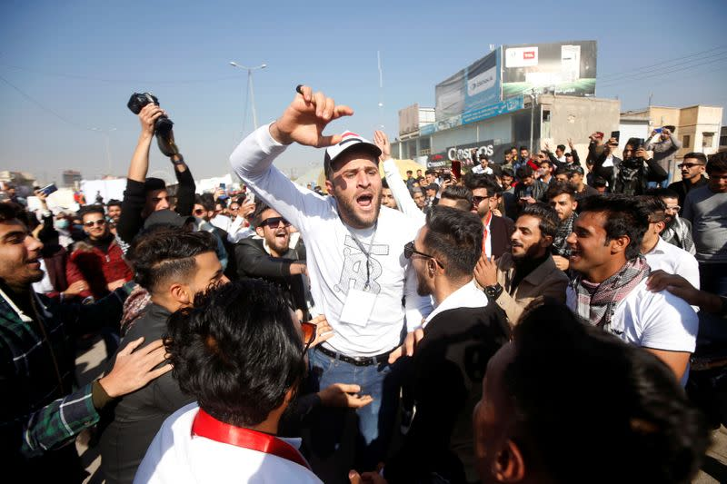 An Iraqi student shouts slogans during ongoing anti-government protests, in Basra