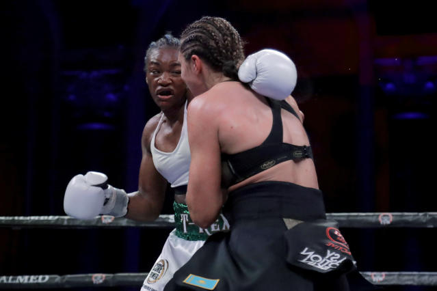 Claressa Shields, left, and Christina Hammer fight during the sixth round of a women's world middleweight championship boxing bout Saturday, April 13, 2019, in Atlantic City, N.J. Shields won by unanimous decision. (AP Photo/Julio Cortez)
