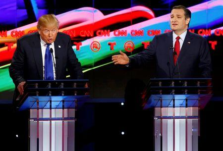 Republican U.S. presidential candidates Donald Trump (L) and Ted Cruz speak simultaneously as they discuss an issue during the debate sponsored by CNN for the 2016 Republican U.S. presidential candidates in Houston, Texas, February 25, 2016. REUTERS/Mike Stone