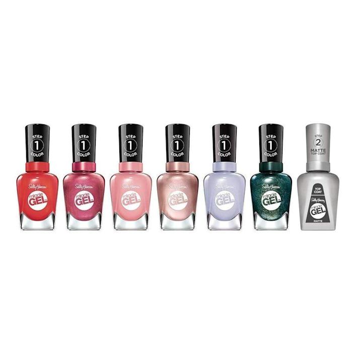 """<p><strong>Sally Hansen</strong></p><p>amazon.com</p><p><strong>$42.43</strong></p><p><a href=""""https://www.amazon.com/dp/B084DVK3BT?tag=syn-yahoo-20&ascsubtag=%5Bartid%7C2141.g.37678990%5Bsrc%7Cyahoo-us"""" rel=""""nofollow noopener"""" target=""""_blank"""" data-ylk=""""slk:SHOP NOW"""" class=""""link rapid-noclick-resp"""">SHOP NOW</a></p><p>For a reasonable $42, they'll get a seven-piece nail polish gift set featuring galaxy-inspired shades like Out of this Pearl, Saturn It Up, Neblue-la, and O-Zone You Didn't. Reviewers have also noted that the polishes go on smoothly and last for about seven days without chips or cracks. </p>"""