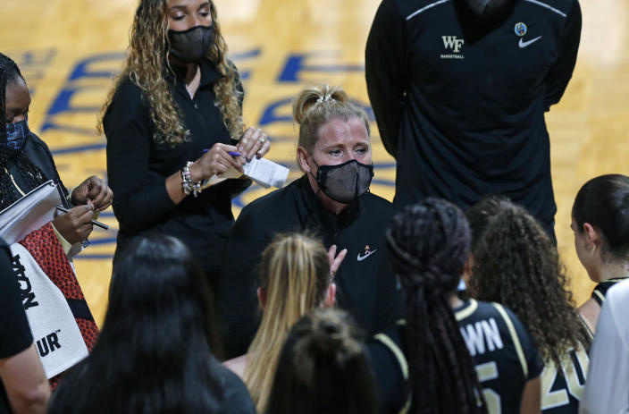 Wake Forest head coach Jennifer Hoover encourages her team during the first half of a college basketball game in the first round of the women's NCAA tournament at the Greehey Arena in San Antonio, Texas, Sunday, March 21, 2021. (AP Photo/Ronald Cortes)