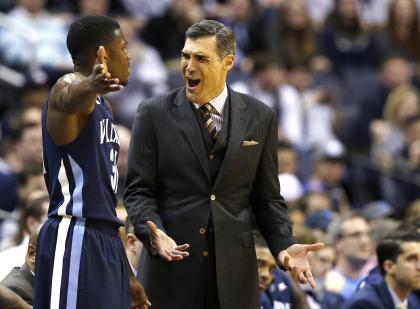 Villanova guard Dylan Ennis talks with head coach Jay Wright during a game against Georgetown. (AP)