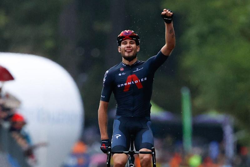 Filippo Ganna celebrates as he crosses the finish line to win the 5th stageAFP
