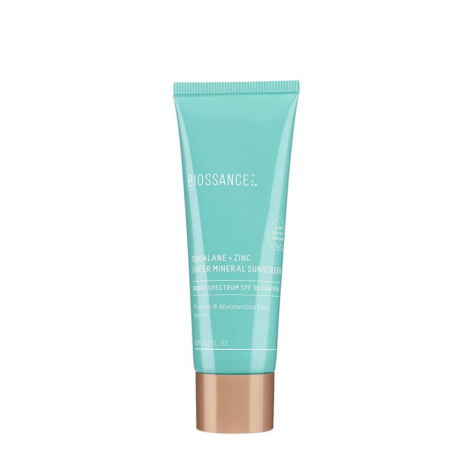 """Biossance's Squalane + Zinc Sheer Mineral Sunscreen SPF 30 doubles as a cooling, velvety-smooth primer — a primer that never cakes or makes skin feel tight, we might add. In fact, it's spiked with <a href=""""https://www.allure.com/story/squalane-vs-squalene-skin-care-difference?mbid=synd_yahoo_rss"""" rel=""""nofollow noopener"""" target=""""_blank"""" data-ylk=""""slk:super-moisturizing squalene"""" class=""""link rapid-noclick-resp"""">super-moisturizing squalene</a> to keep skin supple and hydrated throughout the day."""