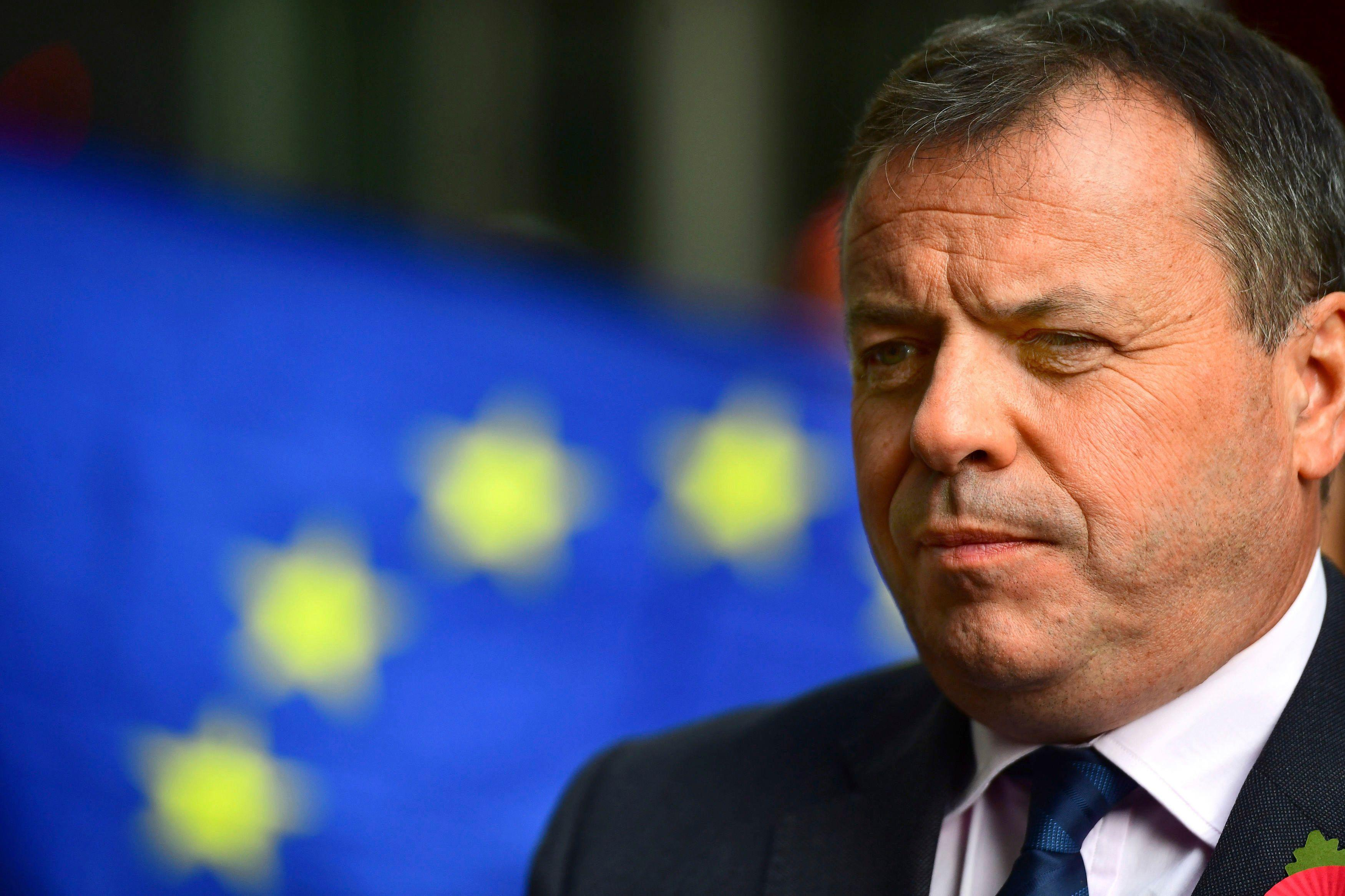 Leave campaigner and businessman Arron Banks, centre, speaks to the media outside BBC Broadcasting House in London, after appearing on the Andrew Marr show, in London, Sunday, Nov. 4, 2018. Britain's National Crime Agency is investigating a main financial backer of the campaign to get Britain out of the European Union over suspected illegal funding during the country's EU membership referendum, authorities said Thursday. (Victoria Jones/PA via AP)